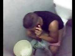 Sitting On Toilet